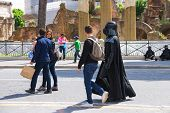 Actor In Costume Darth Vader Walking Down The Street And Attracted The Attention Of Passers  In Rome