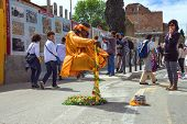 Street Performer In Clothing Monk Demonstrates  Trick Of Levitation In Rome, Italy