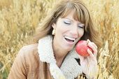 Woman on wheat apple