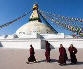 Monks Walking Around Boudhanath Stupa
