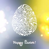 Floral Easter egg background made of doodle pattern on blurred background.