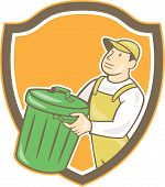 image of garbage bin  - Illustration of a garbage collector carrying garbage waste rubbish bin looking to the side set inside shield crest shape on isolated background done in cartoon style - JPG