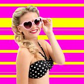 Beautiful glamour girl on colorful striped background