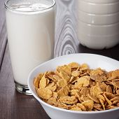 glass of milk and bowl of cornflakes