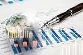 picture of graph  - Background image with financial charts and graphs on the table - JPG