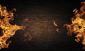 Conceptual image of burning fire on dark background