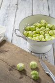 Brussels Sprouts In A Sieve On A Table