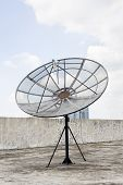 Large Old Television Satellite On Roof At Blue Sky Background