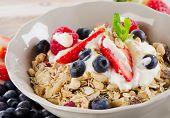 Healthy Breakfast With Ripe Fresh Berries, Yogurt And  Muesli.