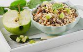 Muesli And Green Ripe Apple For Healthy Breakfast.