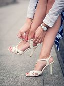 Legs Of Woman With High Heels White Sandals