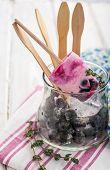 Homemade ice cream with berries blackberry .
