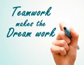 Hand With Pen Writing Team Work Makes The Dream Work