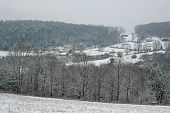stock photo of hilltop  - A snow covered rural hilltop with snow covered trees and houses. ** Note: Soft Focus at 100%, best at smaller sizes - JPG