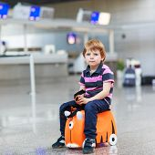Little Boy Going On Vacations Trip With Suitcase At Airport