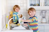 Funny Twin Boys Helping In Kitchen With Washing Dishes