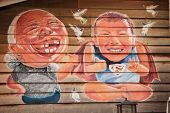 Malaysia, Penang, Georgetown - Circa Jul 2014: Cartoon Style Colored Mural Of An Elderly Woman And A