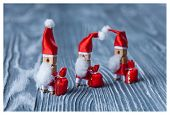 Christmas Concept - Clothespin. Three Of Santa Claus. Retro Santa Claus With A Few Bags Of Gifts. Fa