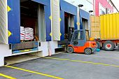 stock photo of loading dock  - Forklift at cargo dock of big warehouse - JPG
