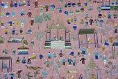 Exterior wall with beautiful mosaic of the pavilion at Xieng Thong temple in Luang Prabang, Laos.