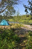 Camping Tent On The Shore Of A Mountain River.