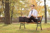 picture of bench  - Relaxed businessman meditating seated on a bench in park  - JPG
