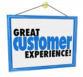 stock photo of experiments  - Great Customer Experience words on a hanging sign in the window of a store - JPG