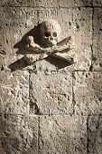 foto of rock carving  - Skull and Crossbones carved in the rock