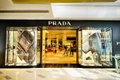 SHENZHEN, CHINA - FEBRUARY 04, 2015: Prada boutique. Prada is an Italian luxury fashion house, specializing in ready-to-wear leather and fashion accessories, shoes, luggage, perfumes, watches, etc.,