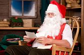 Santa Claus In Workshop With Letters