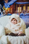 image of bear cub  - Cute funny baby girl is in the suit of bear - JPG