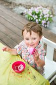 Little Boy Smiles At His Pink Easter Egg
