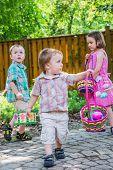 Children On An Easter Egg Hunt Outside