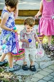 Little Boy Finds A Blue Easter Egg