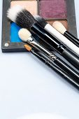 Set of makeup brushes on eye shadow palette