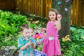 Two Little Girls And A Boy With Their Easter Eggs