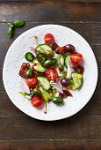 Mediterranean salad with olives and caper berries