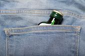 Bottle With Alcohol In Back Pocket Of Blue Jeans