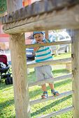 pic of little boys only  - Cute little boy playing on the stairs in playground - JPG