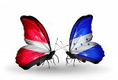 Two Butterflies With Flags On Wings As Symbol Of Relations Latvia And Honduras
