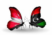 Two Butterflies With Flags On Wings As Symbol Of Relations Latvia And Libya