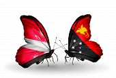 image of papua new guinea  - Two butterflies with flags on wings as symbol of relations Latvia and Papua New Guinea - JPG