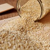 quinoa seeds coming out from a glass jar