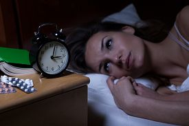 picture of depressed  - Woman and her drugs for depression at night - JPG