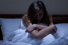 stock photo of suffering  - View of awake woman suffering from depression - JPG