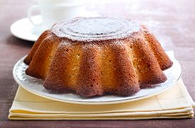 stock photo of icing  - Yogurt citrus cake with icing powder on top - JPG