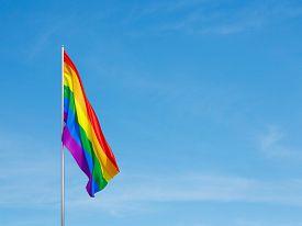 stock photo of transgendered  - Flag of the LGBT community on sky background - JPG