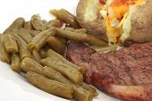 image of ribeye steak  - green beans with steak and baked potato - JPG