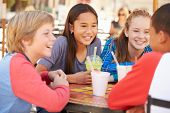 image of pre-adolescent child  - Group Of Children Hanging Out Together In Caf - JPG