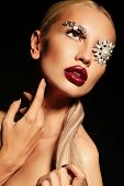 stock photo of fantastic  - fashion studio portrait of beautiful sexy woman with blond hair with fantastic makeup with bijou accessories - JPG